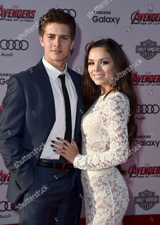 """Billy Unger, left, and Angela Moreno arrive at the Los Angeles premiere of """"Avengers: Age Of Ultron"""" at the Dolby Theatre on"""