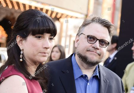 "Director Guillermo Del Toro, right, and his wife Lorenza Newton arrive on the red carpet at the LA premiere of ""Pacific Rim"" at the Dolby Theater on in Los Angeles"