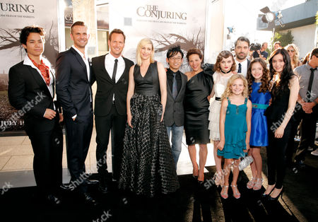 """From left, the cast and crew of """"The Conjuring"""" arrive at the the film's LA premiere at the Cinerama Dome, in Los Angeles. Pictured from left are Shannon Kook, James Brotherton, Patrick Wilson, Vera Farmiga, James Wan, Lili Taylor, Joey King, Kyla Deaver, Mackenzie Foy, Hayley McFarlane and in back row, Ron Livingston"""