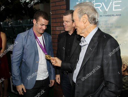 """Cast member Clint Eastwood, right, director Robert Lorenz, center, greet swimmer Tyler Clary at the premiere of """"Trouble With the Curve"""" at the Westwood Village Theater, in Los Angeles"""
