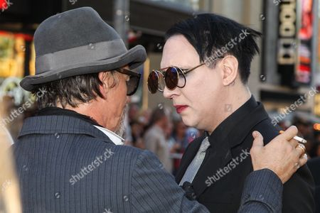 """Tommy Flanagan, left, and Marilyn Manson attend the LA Premiere Screening of """"Sons Of Anarchy"""" at at TCL Chinese Theatre, in Los Angeles"""
