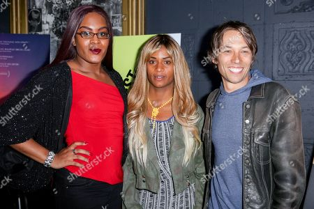 """Mya Taylor, from left, Kitana Kiki Rodriguez and Sean Baker arrive at the LA Special Screening of """"Tangerine"""" at The Theater at Ace Hotel, in Los Angeles"""