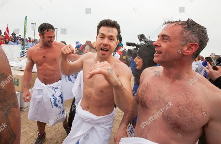Actors Taylor Kinney, Jon Seda and David Eigenberg of the Chicago Fire and Chicago P.D. cast take part in the Chicago Polar Plunge at North Avenue Beach on in Chicago