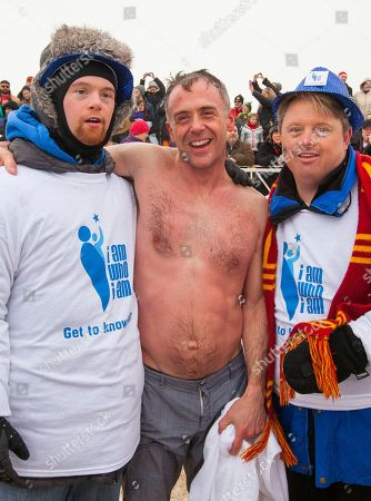 David Eigenberg of the Chicago Fire cast, center, poses and takes part in the Chicago Polar Plunge at North Avenue Beach on in Chicago