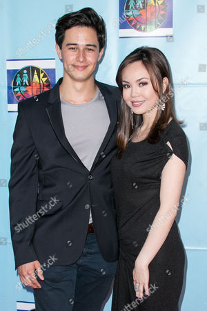 Stock Picture of Ivan Dorschner, left, and Anna Perez De Tagle arrive at the Let's Celebrate! District Wide Arts Festival held at The Academy of Motion Pictures Arts & Sciences, in Beverly Hills, Calif