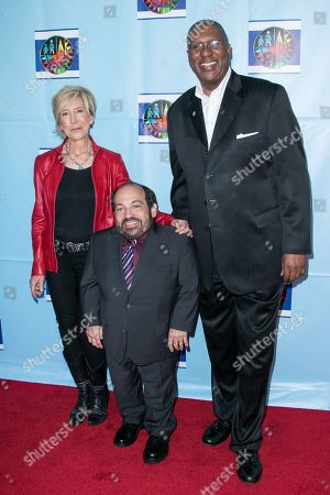 Lin Shaye, from left, Danny Woodburn and Rory Pullens arrive at the Let's Celebrate! District Wide Arts Festival held at The Academy of Motion Pictures Arts & Sciences, in Beverly Hills, Calif