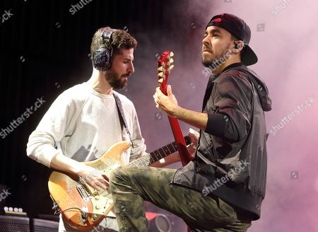 Brad Delson, from left, and Mike Shinoda of the band Linkin Park perform in concert during their Carnivores Tour 2014 at the Susquehanna Bank Center, in Camden, N.J