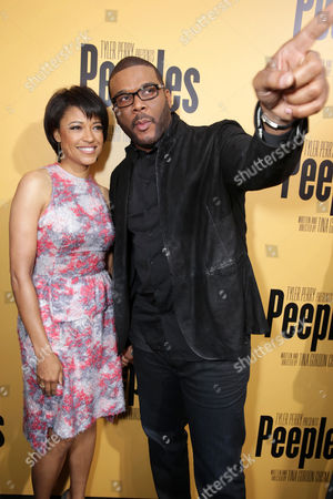 Writer/director Tina Gordon Chism and executive producer Tyler Perry arrive at the Lionsgate Los Angeles Premiere of Peeples, on Wednesday, May, 8, 2013 in Los Angeles