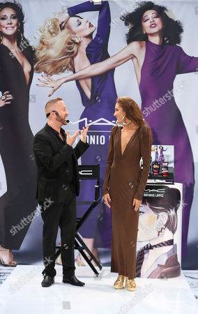 From left, Gregory Arlt, Director of Makeup Artistry for MAC Cosmetics presents with model Angelina McCoy during the MAC Cosmetics media event at South Coast Plaza, in Costa Mesa, Calif
