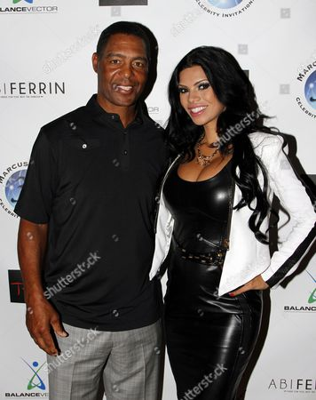 Marcus Allen and model Suelyn Medeiros pose at Marcus Allen Foundation 2013 Celebrity Invitational Poker Tournament on Sunday, June 2nd, 2013 at Lucky Strike Hollywood in Los Angeles, California