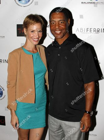 Actress Ashley Scott and Marcus Allen pose at Marcus Allen Foundation 2013 Celebrity Invitational Poker Tournament on Sunday, June 2nd, 2013 at Lucky Strike Hollywood in Los Angeles, California