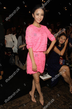 Tong Liya attends the DKNY Spring/Summer 2015 fashion show at Mercedes-Benz Fashion Week on in New York