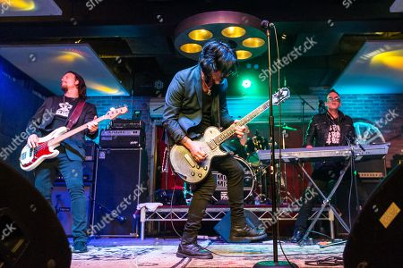 "From left, Sean McNabb, Gilby Clarke, and Steve Ferlazzo performs during the ""Music On A Mission"" benefit concert held at Lucky Strike Live - Hollywood on in Los Angeles"