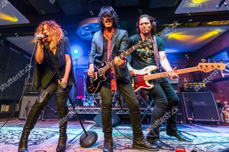 "From left, Nikka Costa, Gilby Clarke, and Sean McNabb perform during the ""Music On A Mission"" benefit concert held at Lucky Strike Live - Hollywood on in Los Angeles"