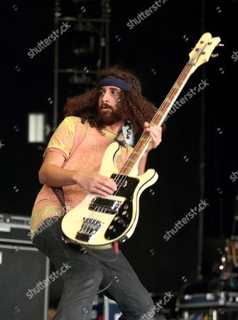 Stock Photo of Ian Peres of the band Wolfmother performs during the MMRBQ at the BB&T Pavilion, in Camden, N.J