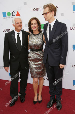 From left, Maurice Marciano, Lilly Tartikoff Karatz, and Philippe Vergne arrive at MOCA's 35th Anniversary Gala presented by Louis Vuitton at The Geffen Contemporary at MOCA on in Los Angeles
