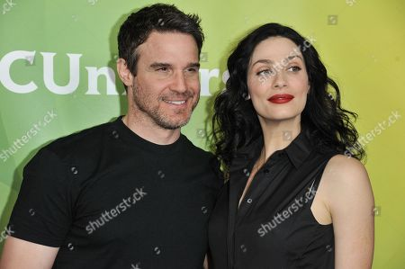Eddie McClintock, left, and Joanne Kelly arrive at the NBC Universal Summer Press Day, in Pasadena, Calif