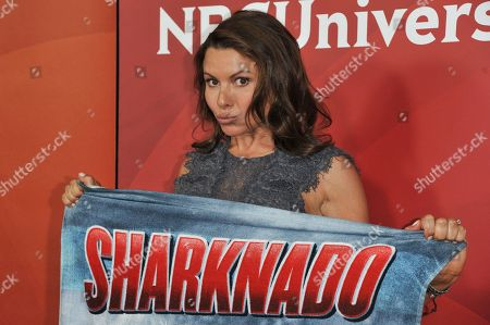 """Kari Wuhrer from the cast of """"Sharknado 2: The Second One"""" arrives at the NBC Universal Summer Press Day, in Pasadena, Calif"""