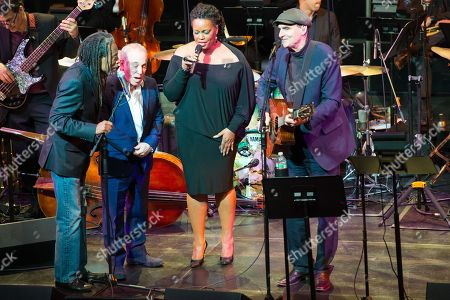 Stock Photo of Bobby McFerrin, left, Paul Simon, second from left, Dianne Reeves, and James Taylor, right, perform at the Nearness of You Concert at Jazz at Lincoln Center, in New York