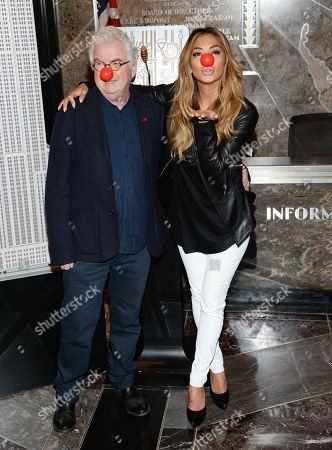 Stock Image of Comic Relief chief executive, Kevin Cahill, and singer Nicole Scherzinger light the Empire State Building in honor of NBC's Red Nose Day entertainment charity event, in New York