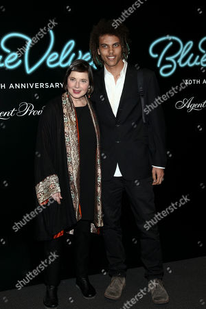 "Stock Image of Isabella Rossellini, left, and Roberto Rossellini, right, attend the 30th anniversary digitally restored special screening of David Lynch's ""Blue Velvet"" at the Museum of Modern Art, in New York"