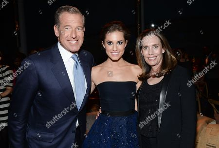 "Actress Allison Williams, center, poses with her parents NBC News anchor Brian Williams and Jane Williams at HBO's ""Girls"" fourth season premiere party at The American Museum of Natural History, in New York"