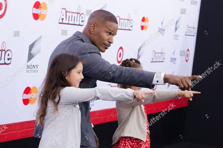 "Actor Jamie Foxx and his daughter, right, Annalise Bishop attend the world premiere of ""Annie"" at the Ziegfeld Theatre, in New York"
