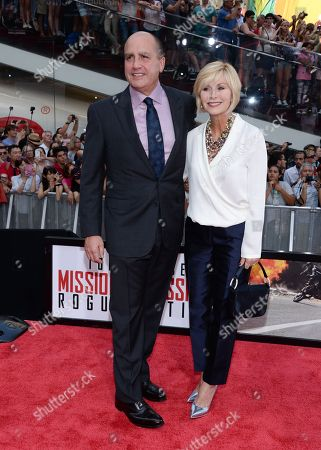 """Producer Don Granger and wife attend the premiere of """"Mission: Impossible - Rogue Nation"""" in Times Square, in New York"""