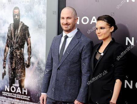 "Director Darren Aronofsky and girlfriend Brandi-Ann Milbradt attend the premiere of ""Noah"" at the Ziegfeld Theatre, in New York"