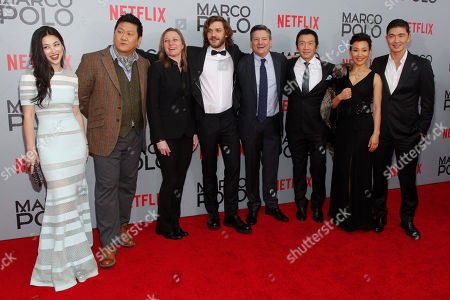 """Zhu Zhu, from left, Benedict Wong, Cindy Holland, Lorenzo Richelmy, Ted Sarandos, Chin Han, Joan Chen and Rick Yune attend the season premiere of the new Netflix series """"Marco Polo"""" at AMC Lincoln Square, in New York"""