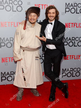 "Stock Image of Amarsaikhan Baljinnyam, left, and Lorenzo Richelmy, right, attend the season premiere of the new Netflix series ""Marco Polo"" at AMC Lincoln Square, in New York"