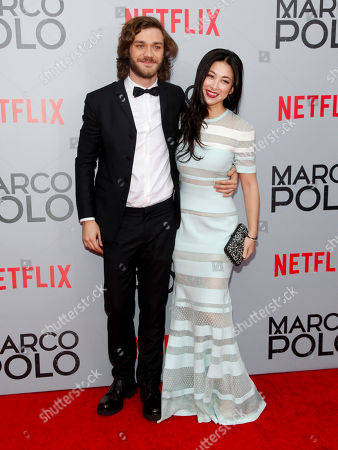 """Lorenzo Richelmy, left, and Zhu Zhu, right, attend the season premiere of the new Netflix series """"Marco Polo"""" at AMC Lincoln Square, in New York"""