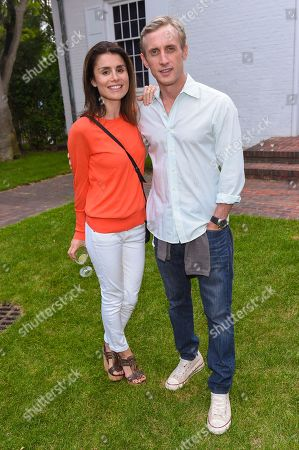 """Stock Image of Dan Abrams, right, and Florinka Pesenti attend a special screening of """"99 Homes"""" at Guild Hall in East Hampton, in New York"""
