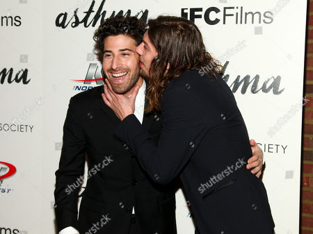 "Jake Hoffman, left, and Benedict Samuel, right, attend a special screening of ""Asthma"", hosted by IFC Films with The Cinema Society, at The Roxy Hotel, in New York"
