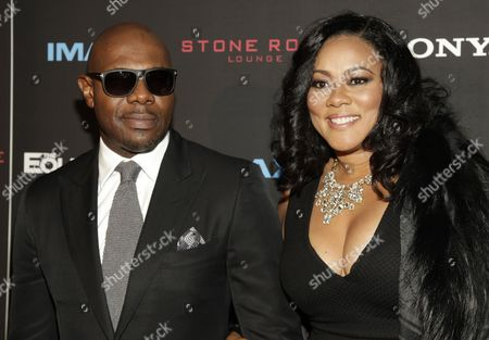 """Antoine Fuqua, left, and Lela Rochon, right, attend a screening of """"The Equalizer"""" on in New York"""