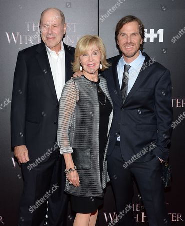 """Director Breck Eisner, left, poses with his parents Jane and Michael Eisner, at a special screening of """"The Last Witch Hunter"""" at the Loews Lincoln Square, in New York"""