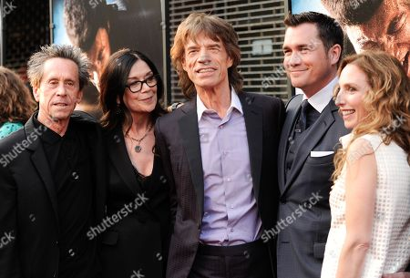 """Producers, from left, Brian Grazer, Victoria Pearman, Mick Jagger, Tate Taylor, Erica Huggins attends the world premiere of """"Get On Up"""" at the Apollo Theater, in New York"""