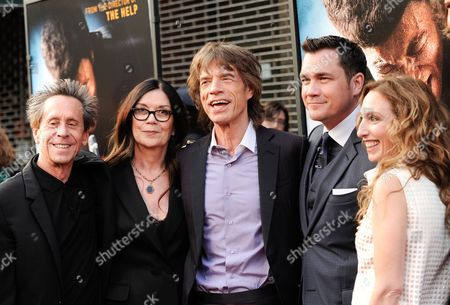 "Producers, from left, Brian Grazer, Victoria Pearman, Mick Jagger, Tate Taylor, Erica Huggins attends the world premiere of ""Get On Up"" at the Apollo Theater, in New York"
