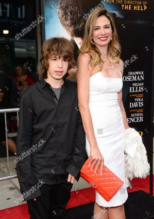 """Stock Photo of Mick Jagger's ex-girlfriend Luciana Gimenez and their son Lucas Maurice Morad-Jagger attend the world premiere of """"Get On Up"""" at the Apollo Theater, in New York"""