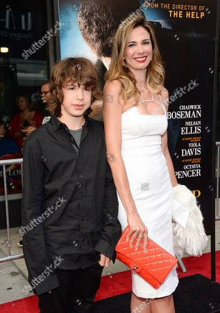 """Mick Jagger's ex-girlfriend Luciana Gimenez and their son Lucas Maurice Morad-Jagger attend the world premiere of """"Get On Up"""" at the Apollo Theater, in New York"""