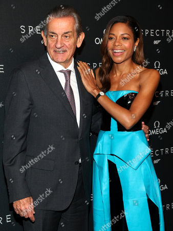 """Stock Picture of President of Omega Stephen Urquhart, left, and actress Naomie Harris, right, attend a special screening of """"Spectre"""" hosted by Omega, at the AMC Loews Lincoln Square, in New York"""