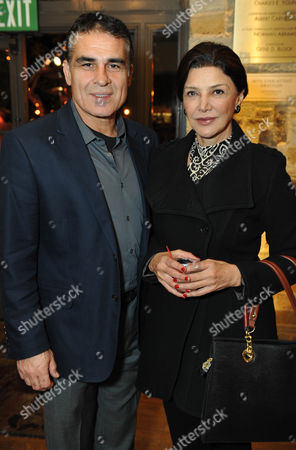Houshang Touzie, left, and Shohreh Aghdashloo are seen at the opening night of Bette Midler in 'I'll Eat You Last: A Chat with Sue Mengers', on at the Geffen Playhouse in Los Angeles