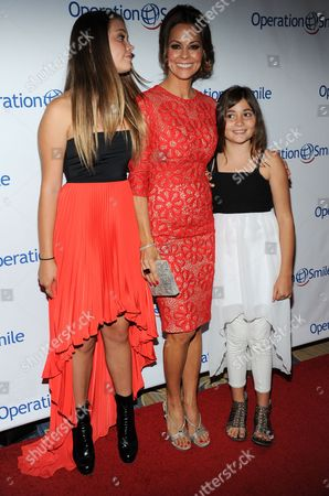 From left, Neriah Fisher, Brooke Burke-Charvet, and Rain Charvet arrive at Operation Smile's 2013 Smile Gala at The Beverly Wilshire Hotel on in Beverly Hills, Calif