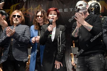 """Geezer Butler, from left, and Ozzy Osbourne of Black Sabbath pose with Sharon Osbourne and Corey Taylor of Slipknot during the """"Ozzfest Meets Knotfest"""" news conference at the Hollywood Palladium, in Los Angeles. The """"Ozzfest Meets Knotfest"""" multi-stage camping festival on Sept. 24-25 at the San Manuel Amphitheater and Festival Grounds in San Bernardino, Calif. was announced at the news conference"""