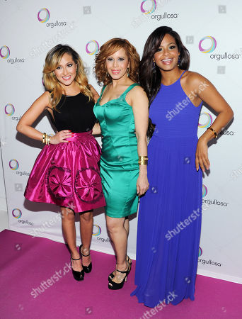 """Stock Image of Singer Christina Milian, left, designer Cenia Paredes and singer Adrienne Bailon attend the P&G Orgullosa """"Skirts Only"""" fashion show on in New York"""
