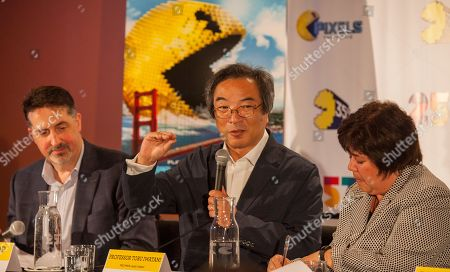 David Bishop of NAMCO USA INC.and Professor Toru Iwatani, PAC-MAN lead creator with interpreter seen at the PAC-MAN's Official 35th Birthday Celebration at LEVEL 257 on in Schaumburg, IL