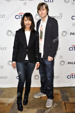 """Maurissa Tancharoen, left, and Jed Whedon arrive at PALEYFEST 2014 - """"Marvel's Agents of S.H.I.E.L.D."""", in Los Angeles"""
