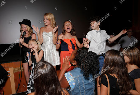 """Emily Alyn Lind, Sterling Griffith, Mary-Charles Jones, and David Mazouz sing karaoke at the premiere of """"Dear Dumb Diary"""" at the Crest Theater on in Los Angeles"""