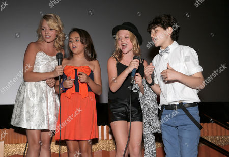 """Sterling Griffith, Mary-Charles Jones, Emily Alyn Lind and David Mazouz sing karaoke at the premiere of """"Dear Dumb Diary"""" at the Crest Theater on in Los Angeles"""