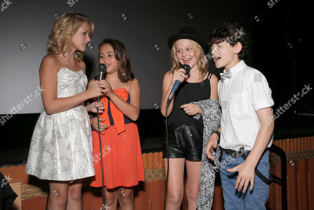 """Stock Image of Sterling Griffith, Mary-Charles Jones, Emily Alyn Lind and David Mazouz sing karaoke at the premiere of """"Dear Dumb Diary"""" at the Crest Theater on in Los Angeles"""